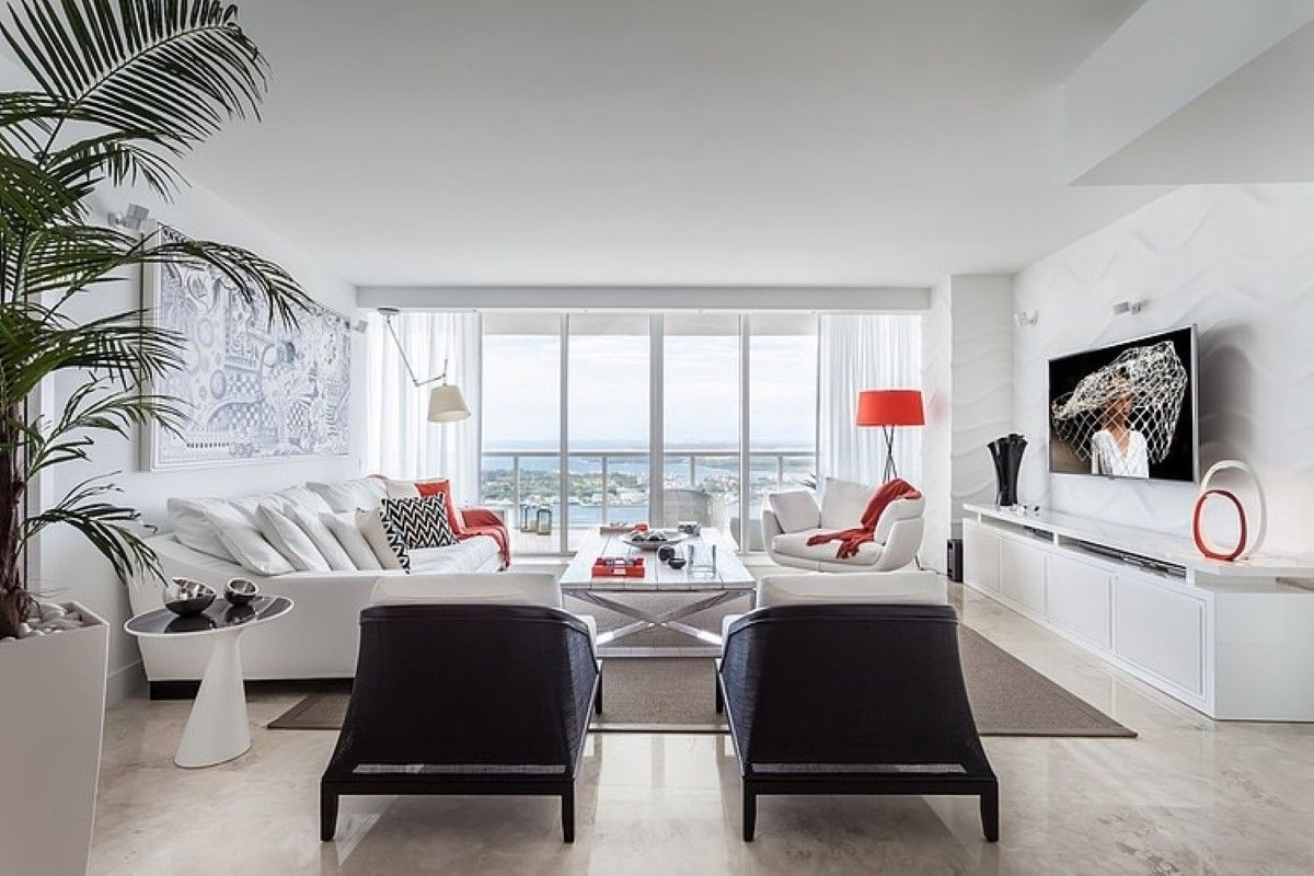 Elegant Spacious Living Room With White Sofa And Black Armchairs ...