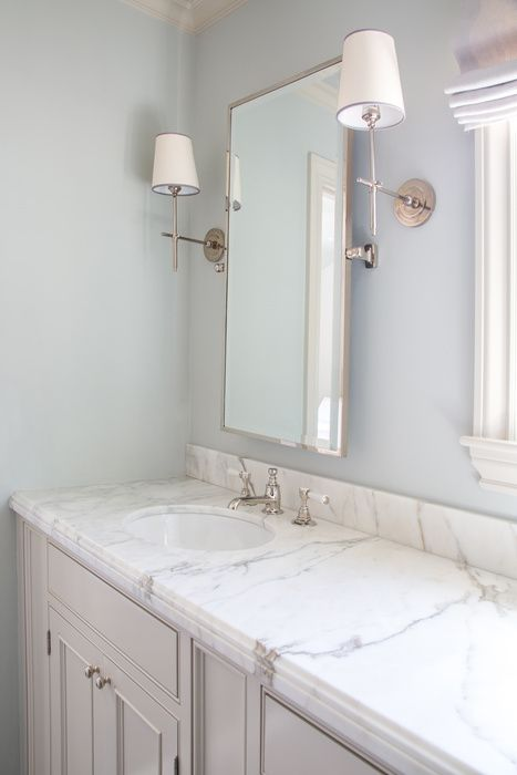 Elegant Gray And Blue Bathroom Boasts Walls Painted Light Blue Lined With A Light  Gray Dual Washstand