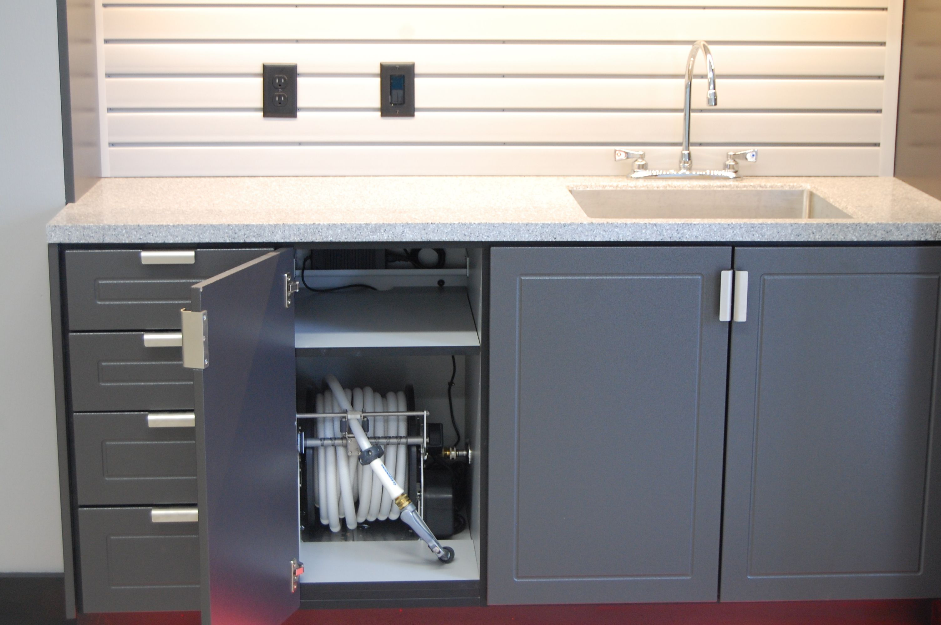 Garage sink cabinet with hidden hose reel. | Garages by Store with ...