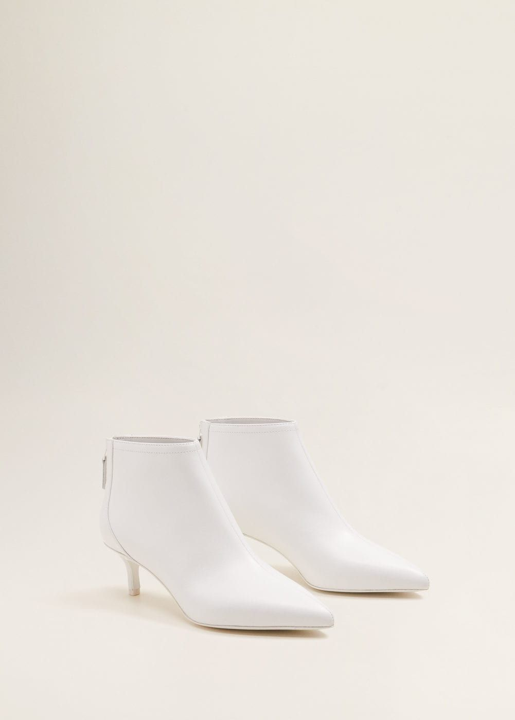 7ae5fa31e42 Zipped white leather ankle boots - these I love.