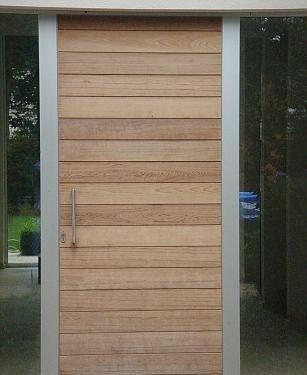 Porte d 39 entree en bois serie rainure portes vente de for Volet bois pour porte fenetre