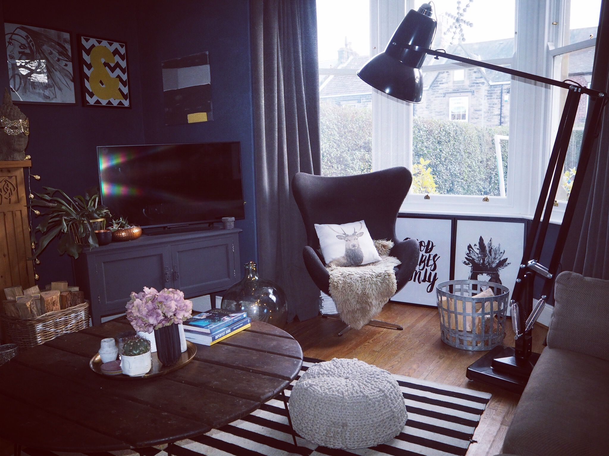 corner of my living room painted in farrow and ball stiffkey blue