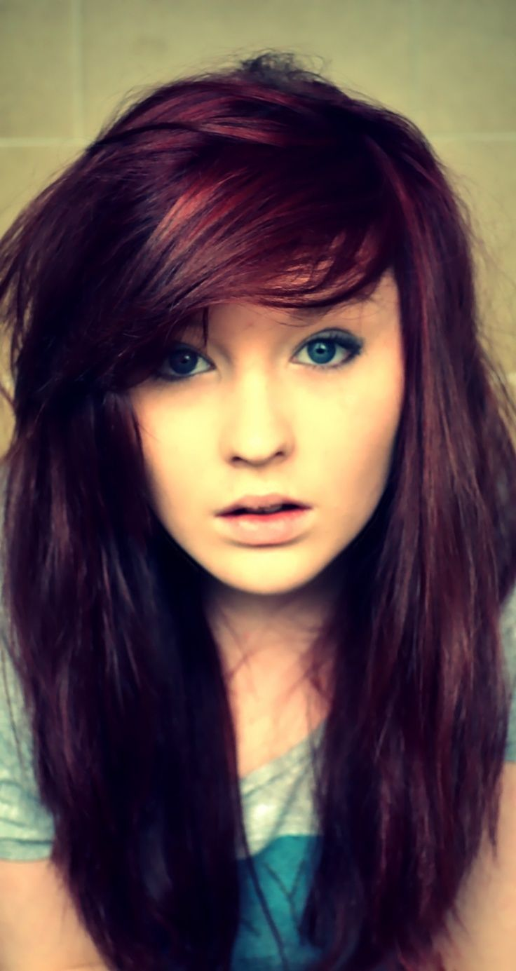 Stunning vibrant red purple hair color with burgundy highlights
