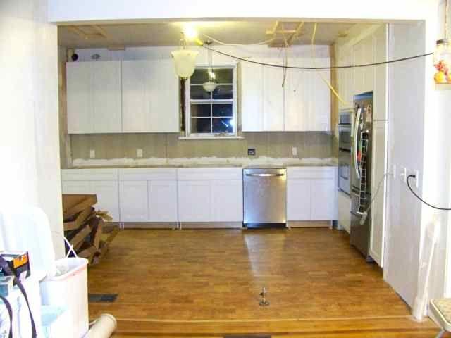 Installing Base Cabinets | Base cabinets, Cabinet, Kitchen ...