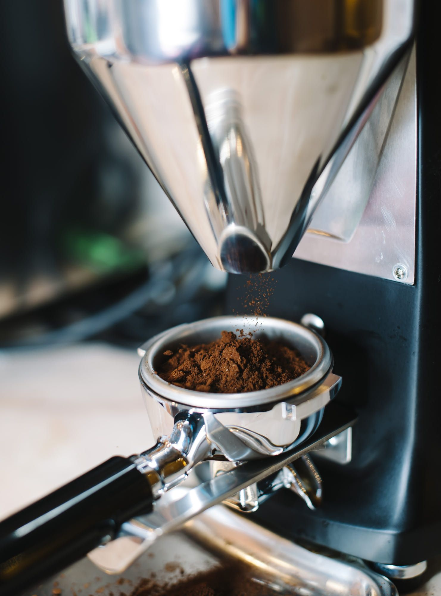 Coffee grinder grinds fresh coffee beans into a portafilter | Fresh coffee  beans, Coffee, Coffee grinds
