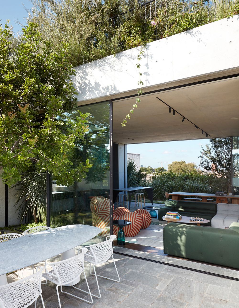 A Factory Rooftop Turned Lush Penthouse Garden is part of Rooftop design, Penthouse garden, Backyard, Rooftop garden, Garden design, Rooftop - SJB director Adam Haddow's apartment opens to a stunning rooftop garden designed by William Dangar of Dangar Barin Smith