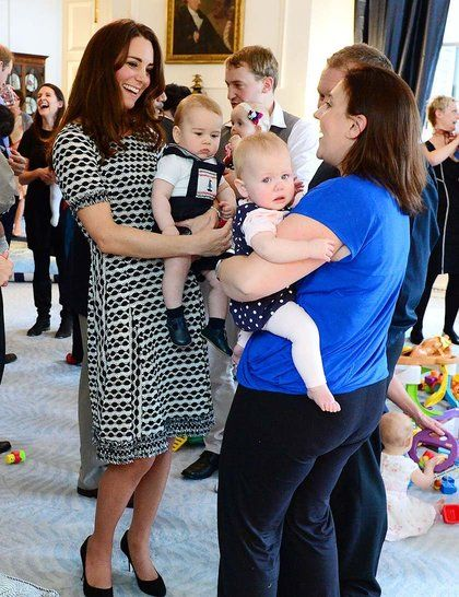 Kate, wearing Tory Burch, talks to other mothers at the Plunket nurses and parents play group event, New Zealand.