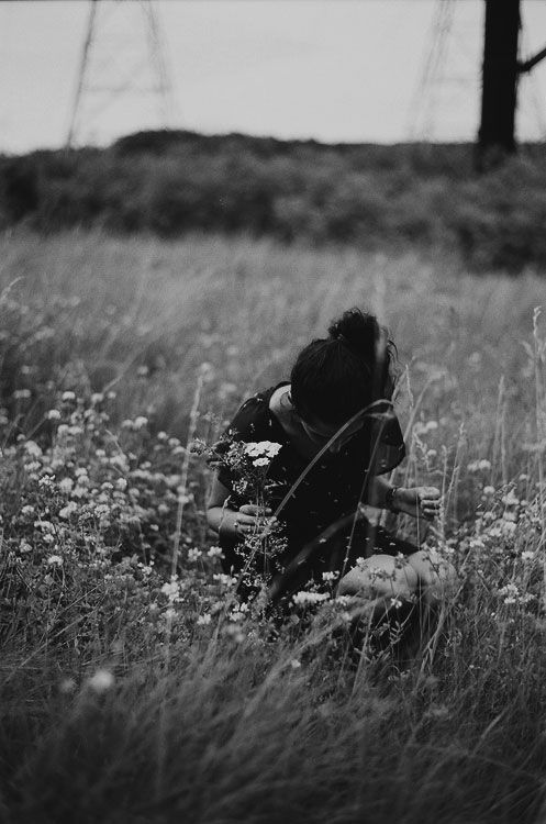 Vintage Photography Girl Picking Up Flowers In A Field Cute Black And White