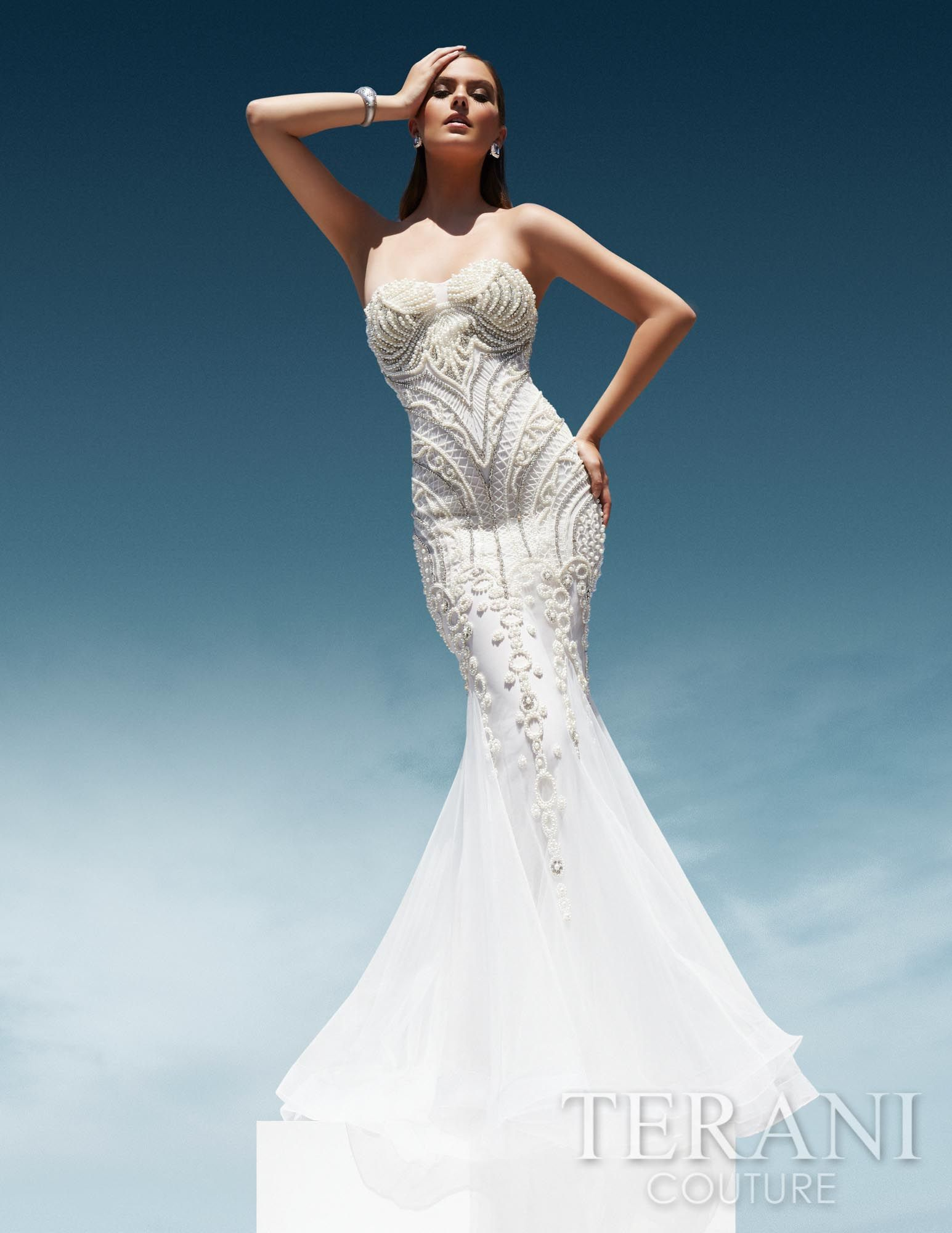 Fitted trumpet gown embellished with sequins and pearls, finished with a flared skirt composed of delicate mesh godets