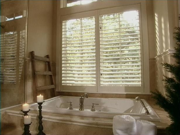 The first thing that greets you upon entering the master bath is the the first thing that greets you upon entering the master bath is the huge step up tub with a large window and fantastic view the window is shuttered m4hsunfo