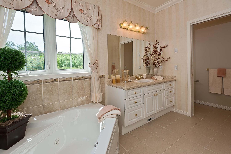The Rosedale. Master bath. Ceramic tile, corner tub, whirlpool tub ...