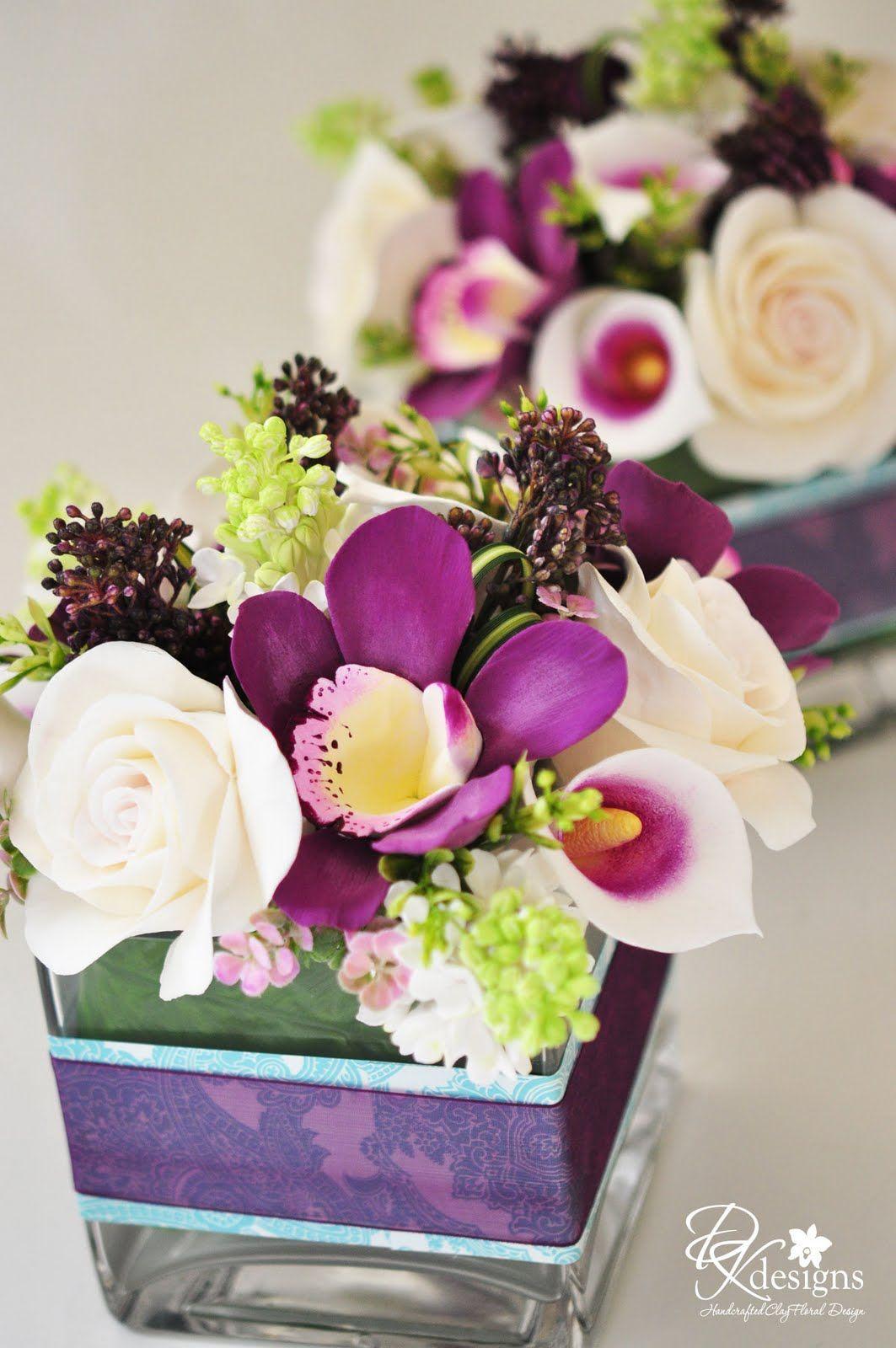 plum orchid centerpieces