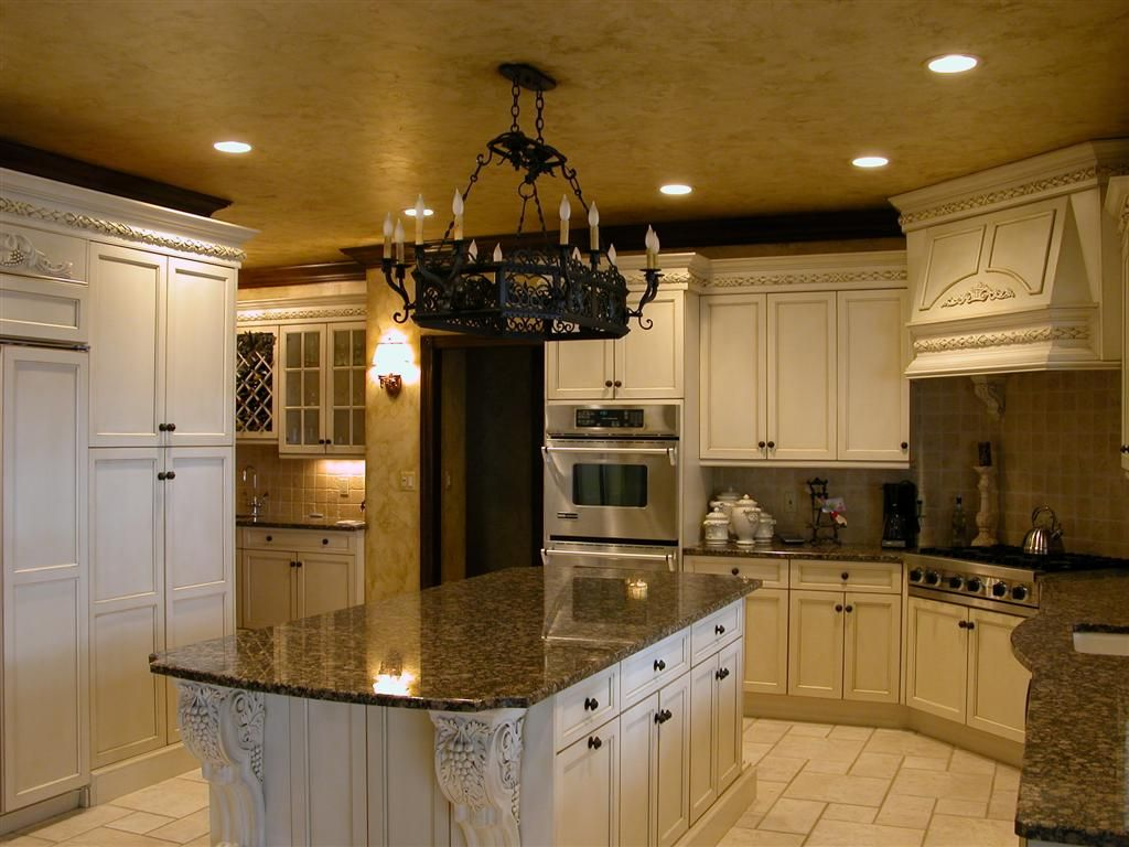 As much as I love modern design, I also LOVE Tuscan-inspired kitchens. Maybe I'll put this in my vacation home. :)