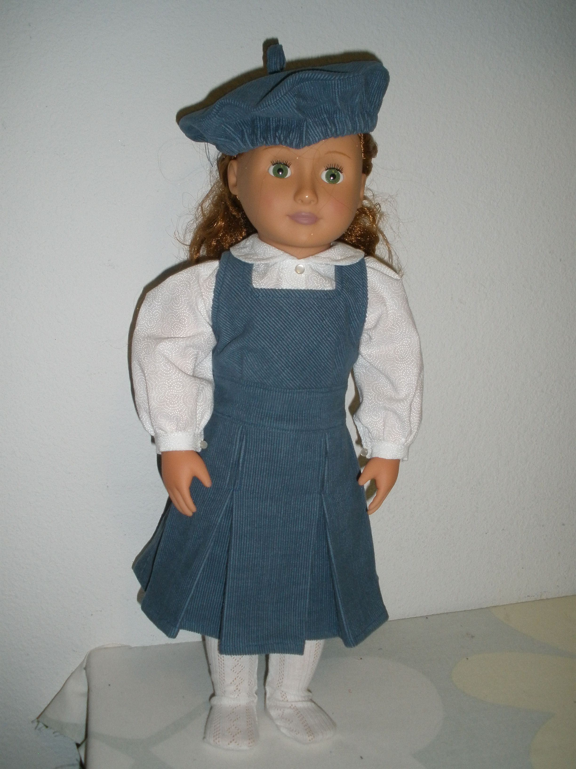 Blue corduroy jump suit outfit. Velcro openings, tam, blouse, dress.