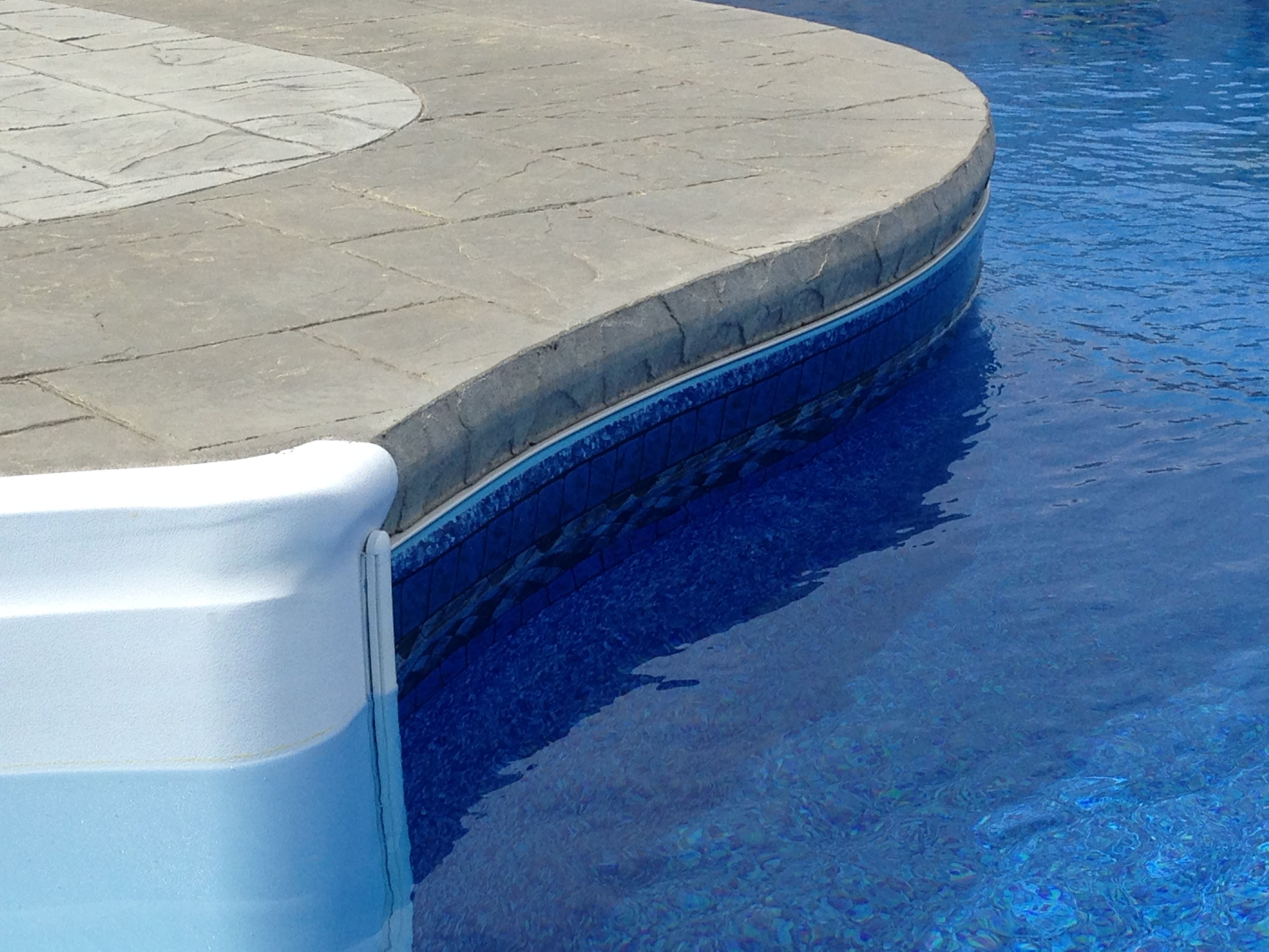 Imperial ashlar slate stamped concrete pool deck with for Concrete pool