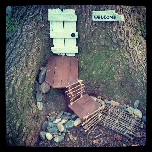 """Here's my (& my boyfriend's) version of a garden gnome home at the base of a tree. I still have work to do, but the basic structure is in place. I love the little """"shanty door"""" we created!"""