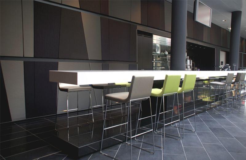 Office coffee bar interior design by Casper Schwarz C4ID. Acoustic wall paneling kvadrat. Stools Andreu world.