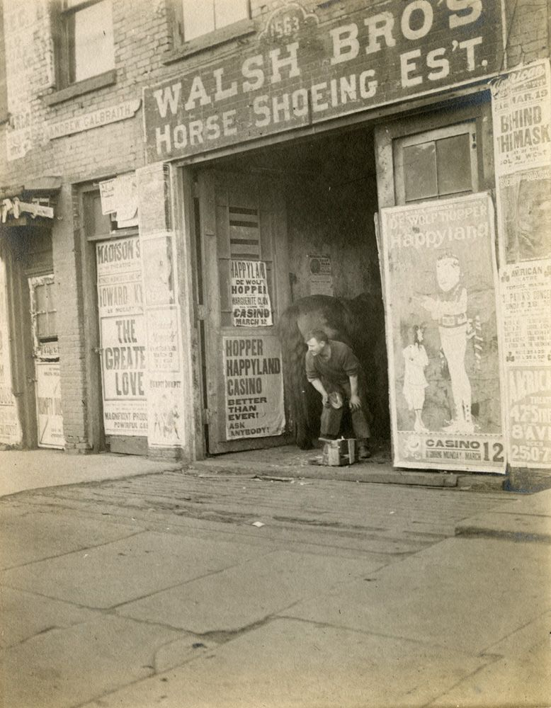 Walsh Bros. Horse Shoeing Es't., Broadway between 46th and 47th Streets, ca. 1905, photograph by Charles Gilbert Hine, PR 082.  NYHS Image #83834d.
