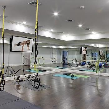 basement gym with mirrored walls and wood floors in 2019