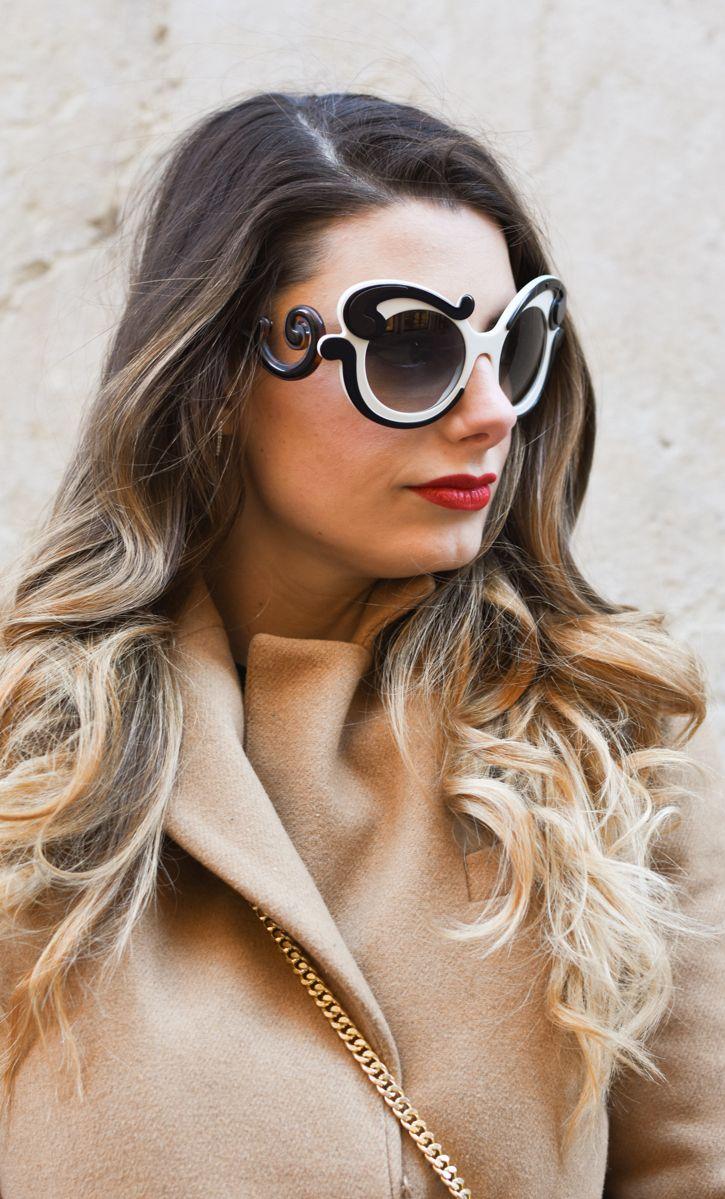 5afe0cfd128b Minimal Prada Baroque sunglasses are a multilayered plastic acetate frame