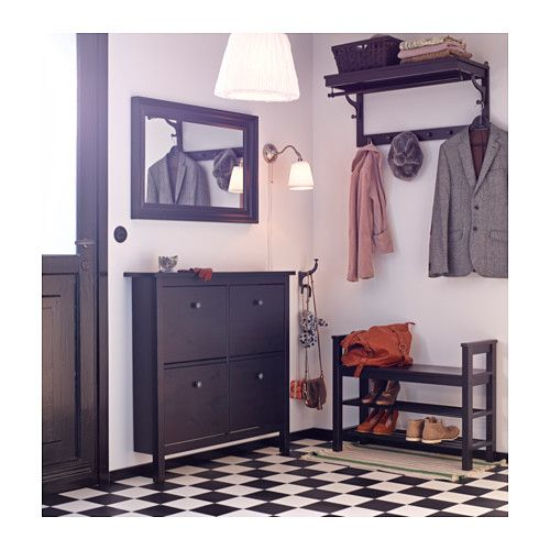 a hallway with shoe cabinet bench with shoe storage hat rack and mirror all in blackbrown entryway idea