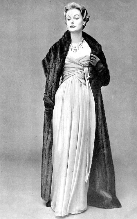 Monique Chevalier wearing a light green mousseline dress   long mink stole  by Christian Dior 547469e2534