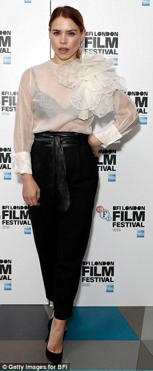Hell for leather: Loose fitting black trousers, black heels and a leather belt added to the look