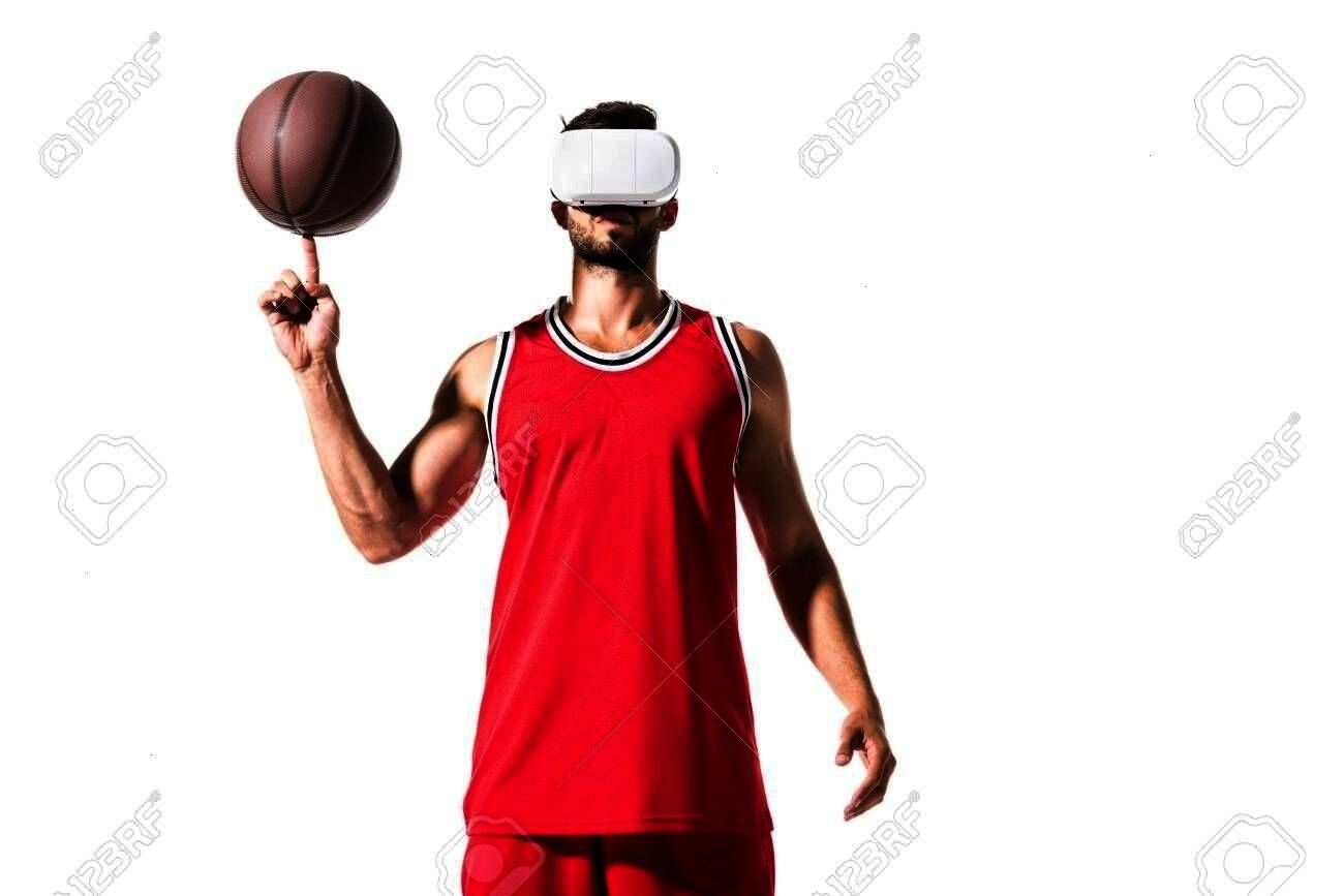 on finger ball in virtual reality headset Isolated On White Stock Photo basketball player spinning on finger ball in virtual reality headset Isolated On White Stock Photo...