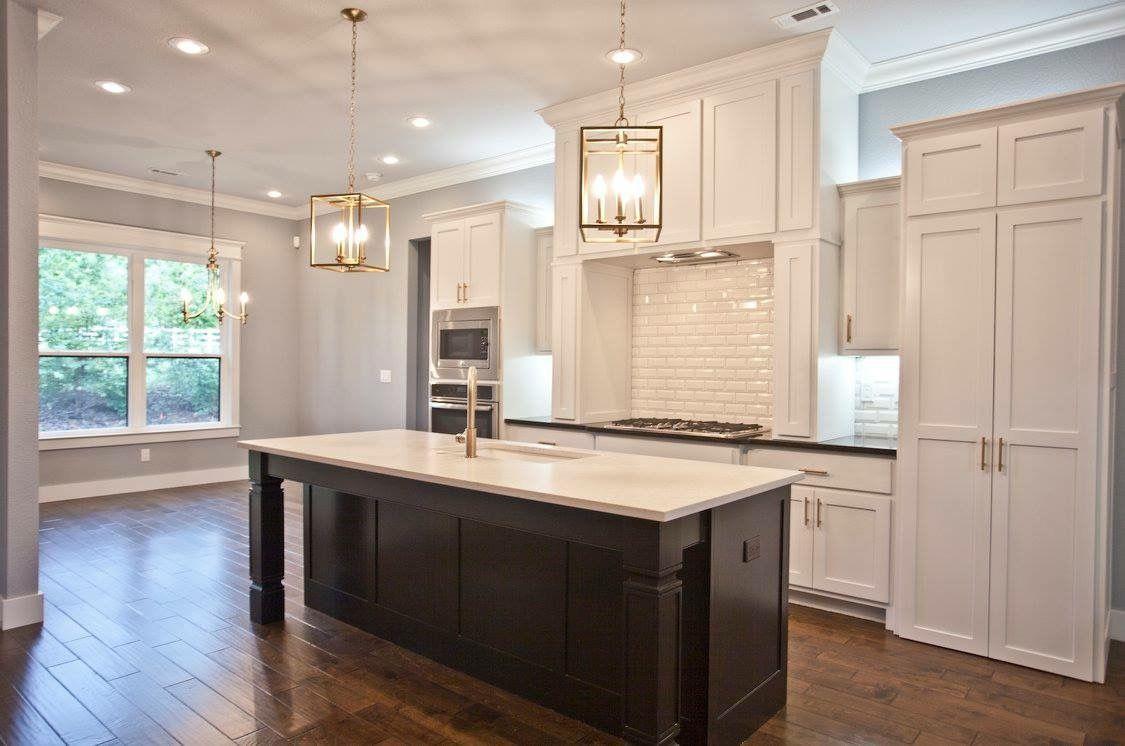 Black Kitchen Island With White Kitchen Cabinets Beveled White Subway Tile Silestone Lagoon Wood Floor Kitchen Black Kitchen Island Cabinets And Countertops
