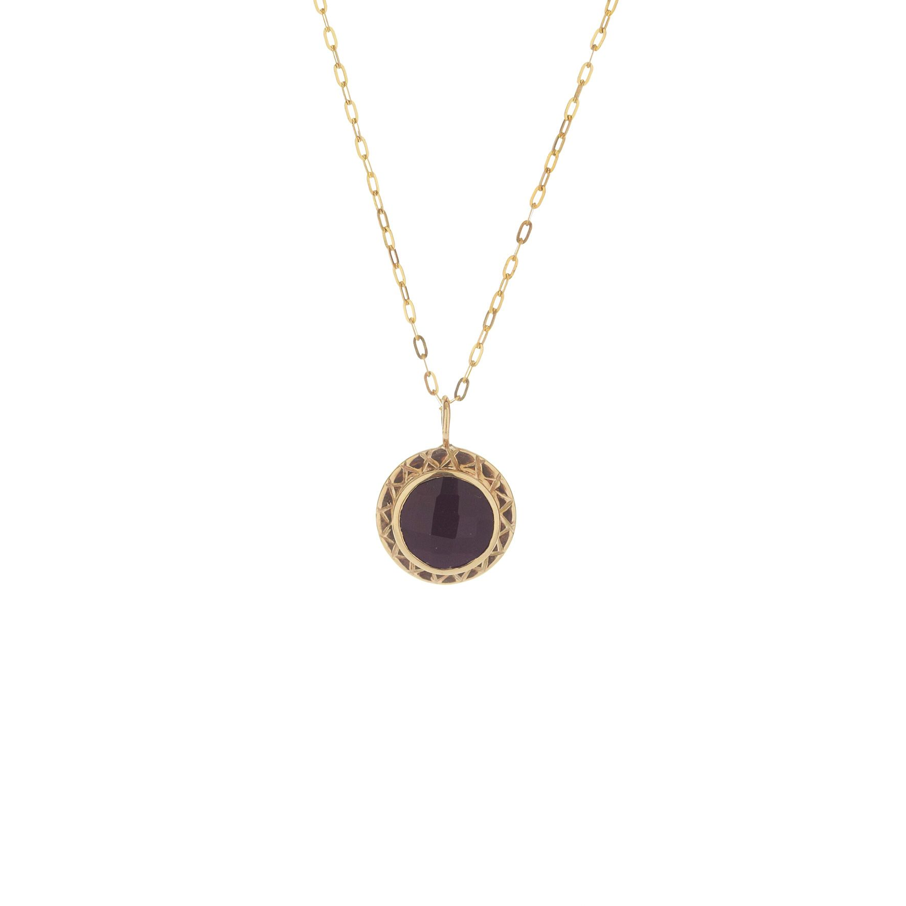 A mm black spinel bezel set in ct yellow gold on a thin gold