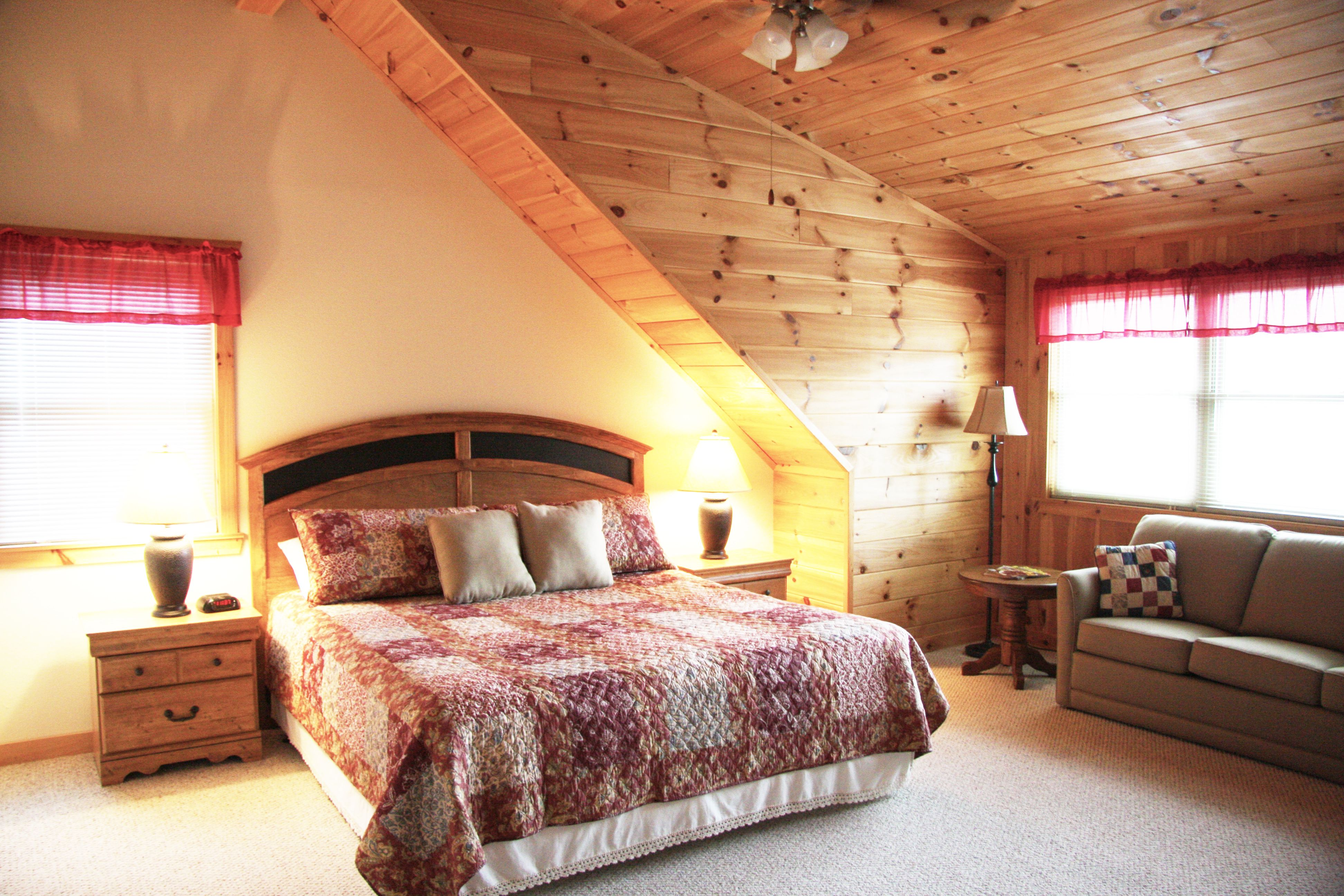 The first bedroom at Mountain Aire cabin has a King bed