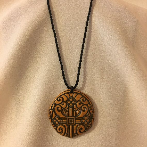Hand Crafted Polymer Clay with a Cross and by DesignsByLyndseyCo