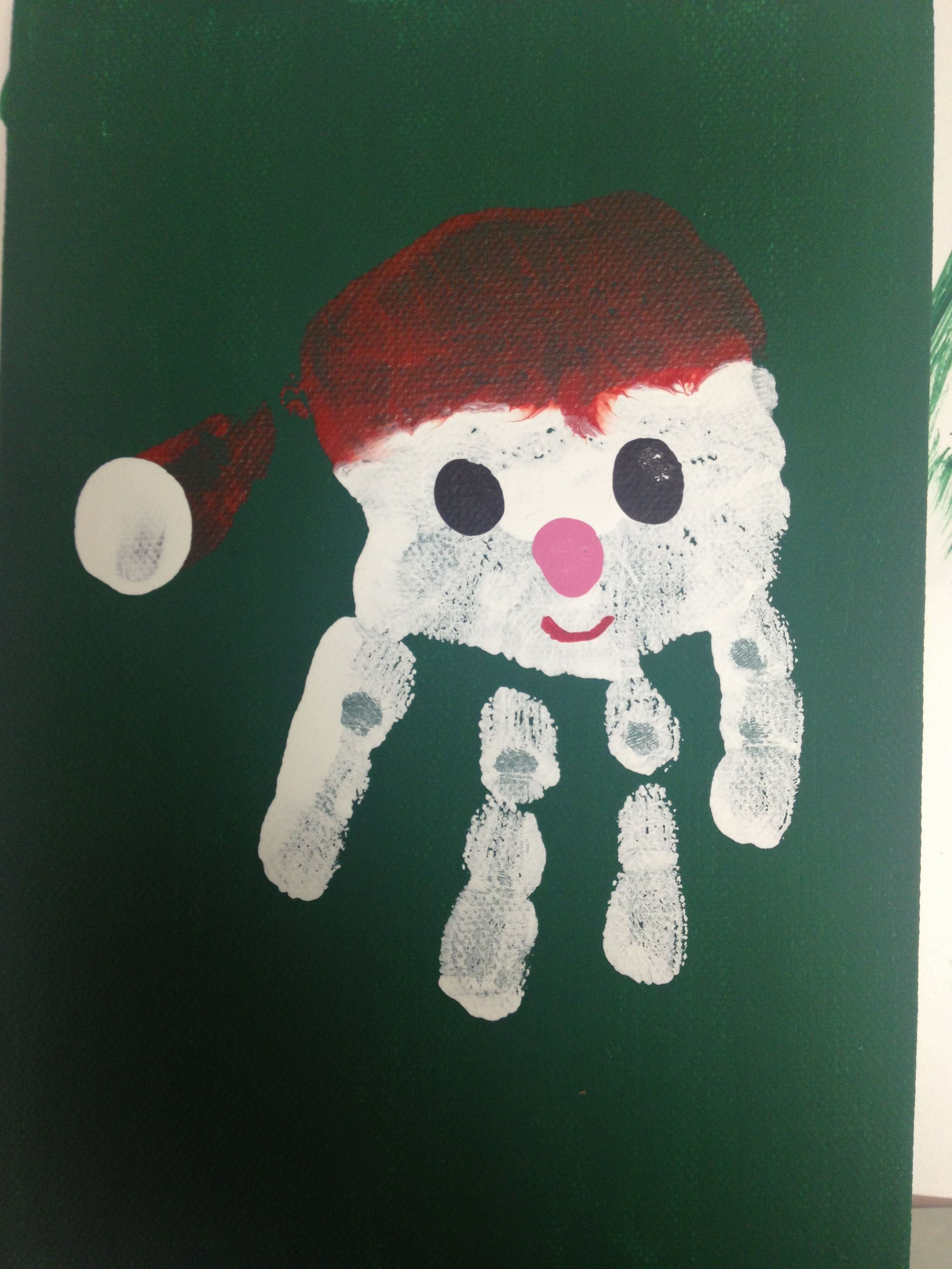 Santa Handprint On 5X7 Canvas Painted With Green Acrylic Paint