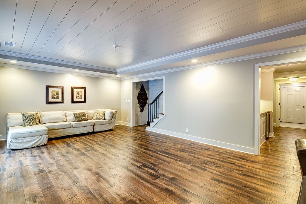 Traditional Basement With Crown Molding High Ceiling Woodhaven Plank Wood Ceiling Hardwood Floors Basement Ceiling Basement Remodeling Basement Design