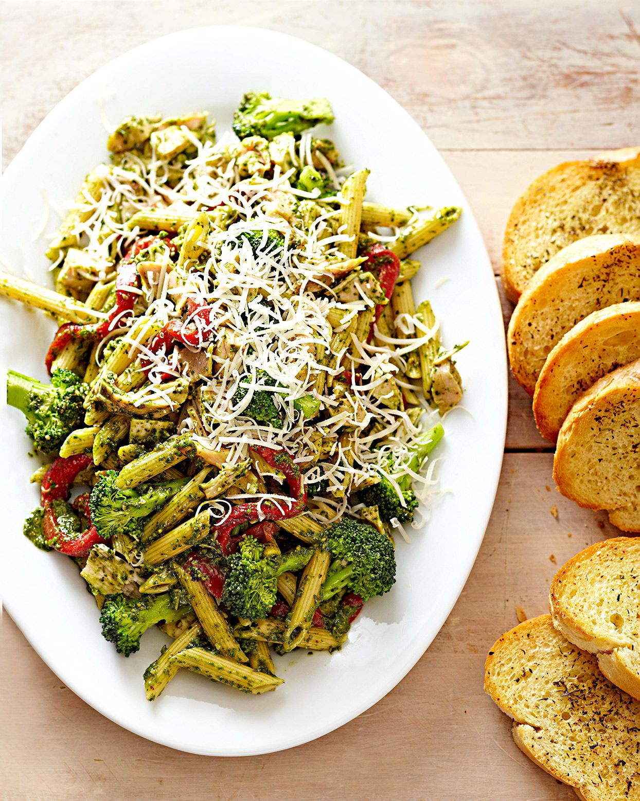 Only 20 minutes stand between you and this rave-worthy pasta platter. We love substituting pesto for marinara sauce every so often for a burst of freshness, but that's not the only reason to fall for this chicken pasta recipe. #dinnerideas #chickenrecipes #bestchickenrecipes #easydinnerideas #bhg