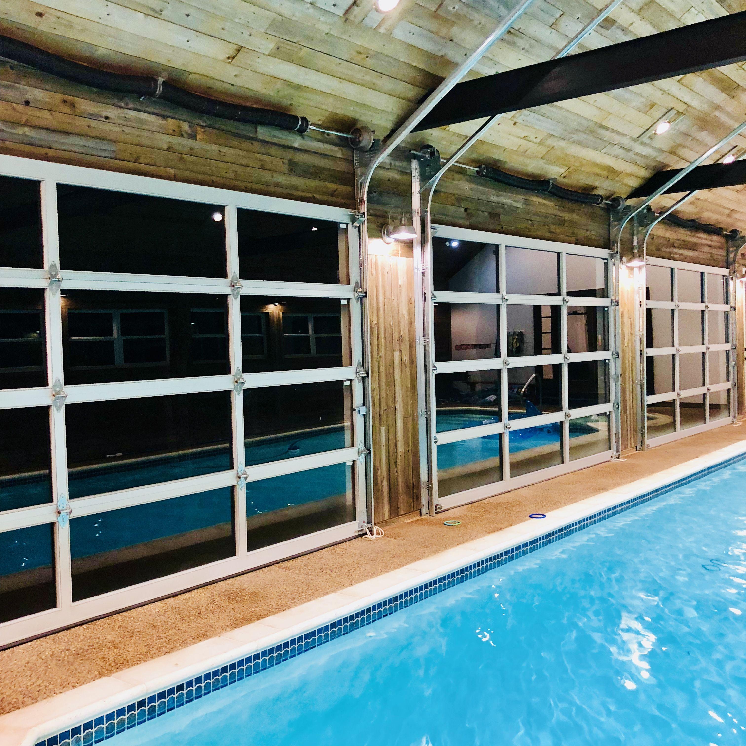 Indoor Pool With Glass Garage Doors Indoor Swimming Pool Design