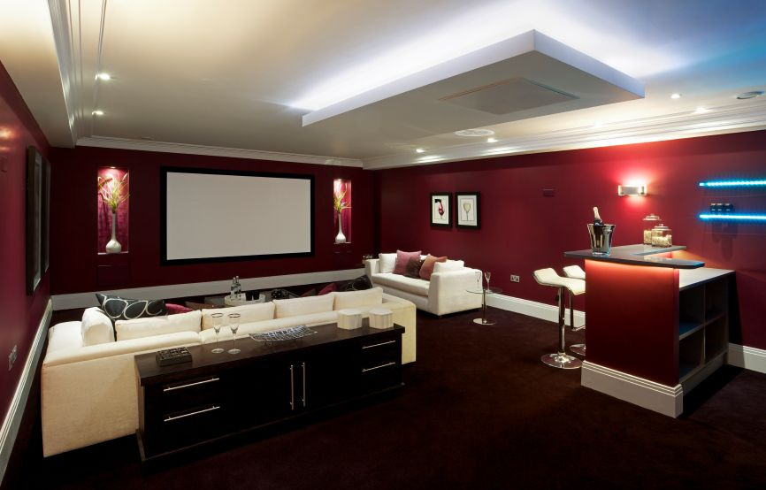 Another Bold Red Media Room With A Black Buffet Behind The Sectional Sofa In Right Corner Of Is Small L Shaped Bar Area