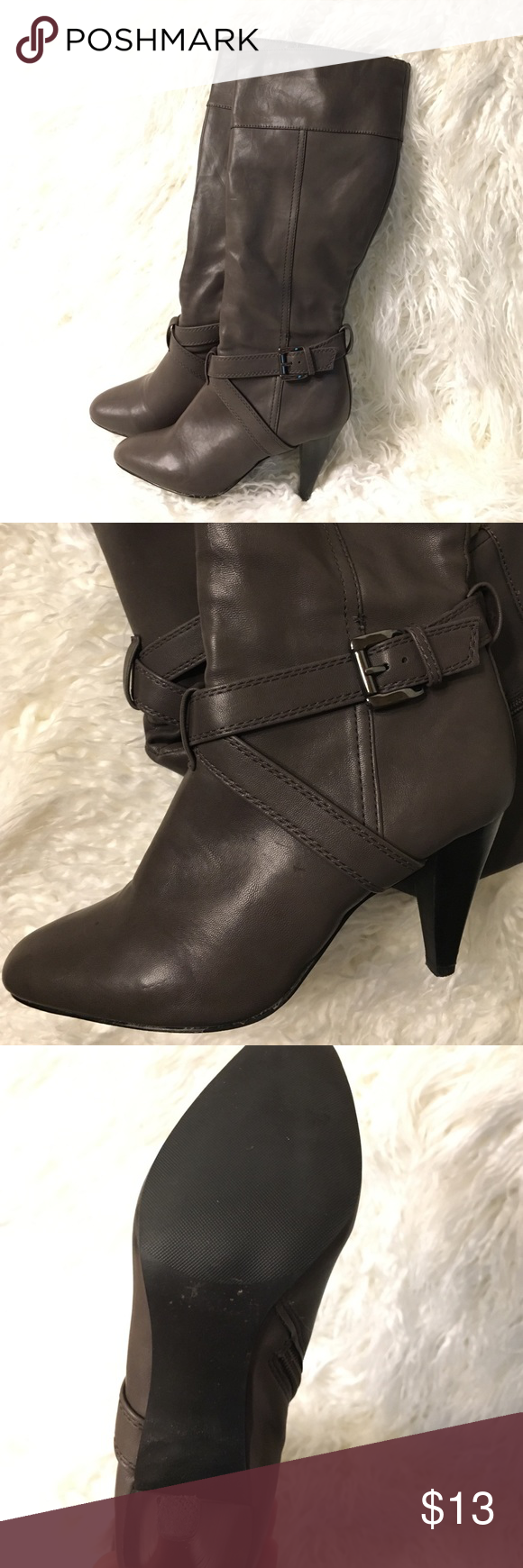 Grey brown heel boots Grey brown heel boots faux leather they were lightly used but does have a small tear to back of right heel got caught in floor crack. I'm sure it can be fixed price is set extremely low for that reason Shoes Heeled Boots