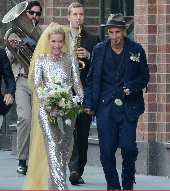 """Piper Perabo is off the market!  The """"Covert Affairs"""" star married her boyfriend Stephen Kay in New York City over the weekend.  The 37-year-old actress looked radiant on her big day, donning a textured metallic Michael Kors gown with a gold veil."""