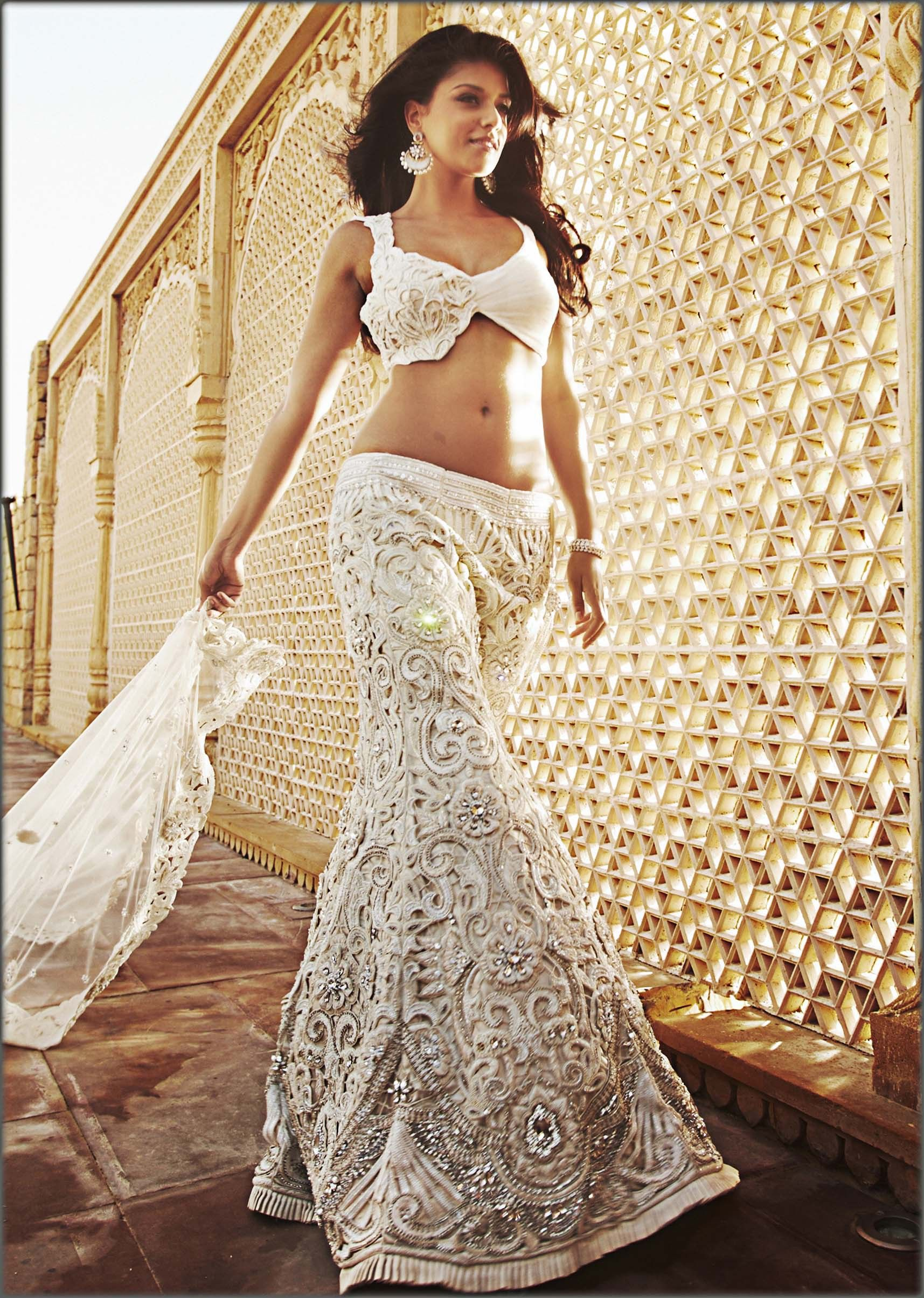 Off white cutwork lehenga by Kalki.The blouse can be ...
