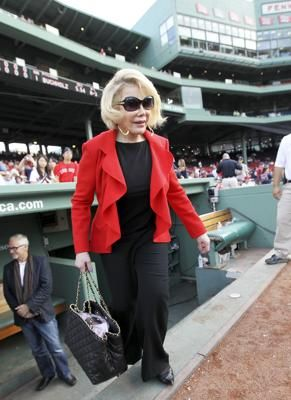 Joan Rivers stepped out of the Red Sox dugout during a visit to Fenway Park on July 19. http://www.boston.com/ae/celebrity/hollywood-celebrities-hit-the-hub/YjWRc4yjNmfm1Mw2Ts7t3H/gallery.html#