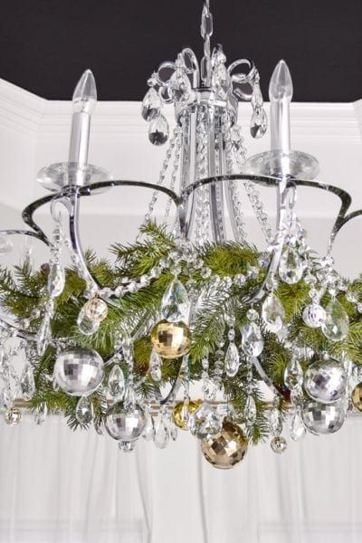 Simple Christmas chandelier decoration ideas- an easy, quick, budget friendly holiday tutorial using garland and wreaths for gorgeous home decor!   #christmasdecor #christmasdecorations #christmasdecorationideas #christmasideas #holidaydecor #holidaydecorations #chandelierlighting #monicawantsit