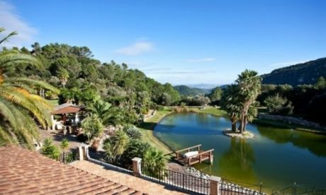 Mansion for sale in Esporles, Mallorca, Spain. Several heated pools, a private lake, a tennis court.
