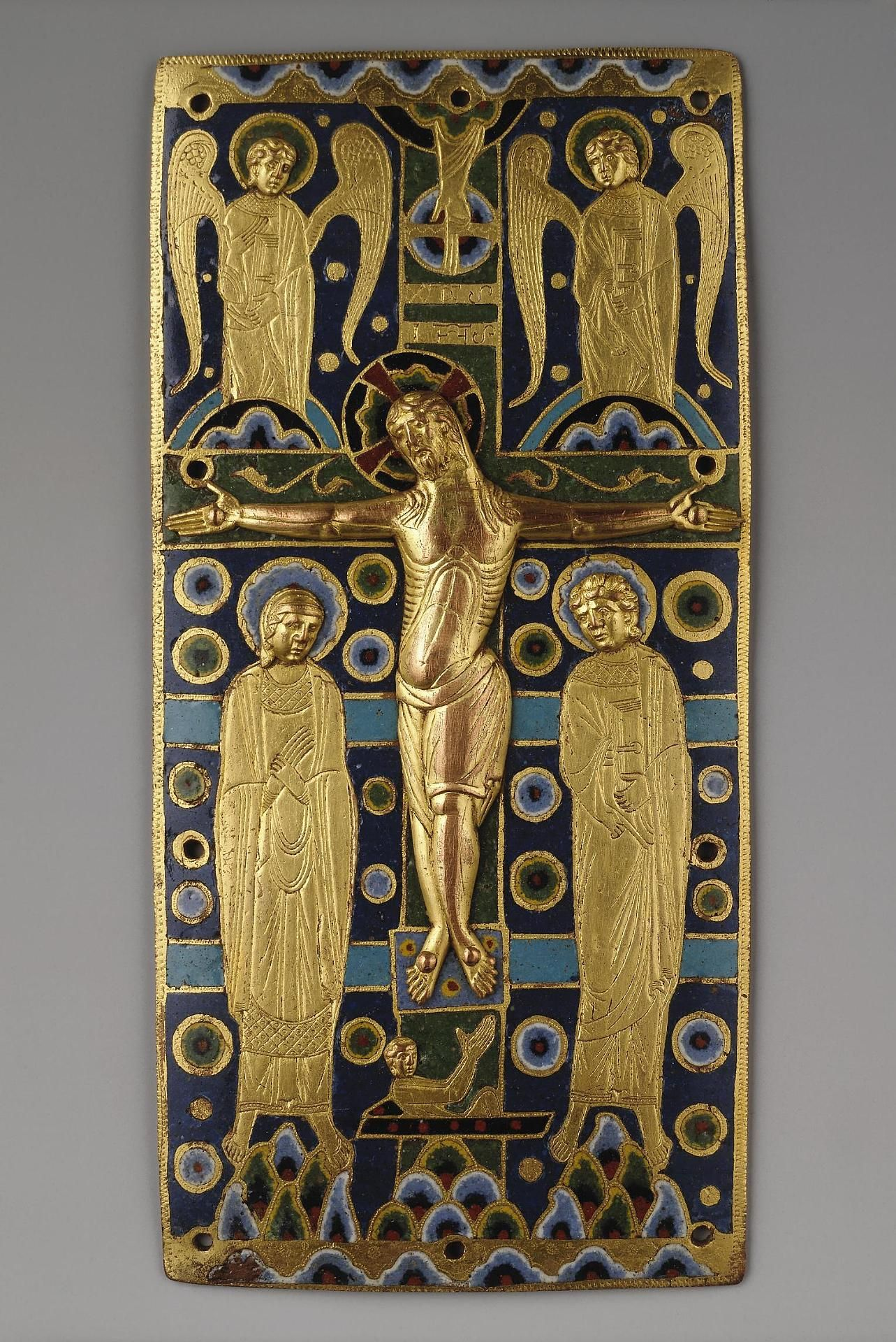 Plaque from a Book-Cover with the Crucifixion Place of creation: France Date: Between 1190 and 1215 School: Limoges Material: copper, enamel