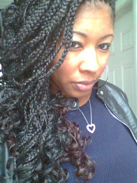 Curly box braids. Dark hair on top, brown on bottom