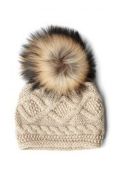 I JUST bought a fur pom like this.....can't wait to find the perfect pattern for the hat! :)