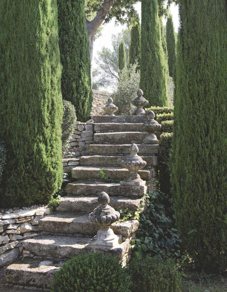 8 ways to create your French garden for 2020 is part of Garden stairs, French garden, Italian garden, Garden design, Landscape design, Garden steps - A classic French garden has several key ingredients which can be easily replicated no matter how big or small your outdoor space is  Topiary, pottery, antique urns and fountains are easy ways to add French accents to your garden, patio, terrace or courtyard  One  French topiary Boxwood does well in shady gardens and the planning and maintenance are well worth the effort for a stunning lush display Symmetry and axes are classic design features in traditional French gardens  Mounting a weathered planter on a podium is a lovely way to add height and interest at the end of a garden path  Two  French pottery Antique and vintage pottery filled with greenery is a lovely way to create a focal point in your garden or to highlight architectural features such as a doorway or garden gate  Ancient biot jars were used for storing olives and olive oil  They add an instant Mediterranean touch to any garden  Classic Anduze urns are perfect for any garden or courtyard  Traditionally they were planted with citrus trees  Three  French garden finials Emphasize architectural features in your garden with sculptural finials  This rose garden would be far less impressive without these beautifully weathered garden finials mounted on columns  Pottery placed on the corners of a swimming pool is a lovely way to make your pool even more beautiful and grand  Classic French garden furniture on the lawn makes this an irresistible spot to spend the afternoon  Four  A French fountain Running water in a garden evokes memories of Provencal villages  There is the constant sound of running water from an incredible network of natural sources  A simple and beautiful faucet into a trough completely changes the feel of any garden or courtyard  Five  French roses and lavender French roses and round lavender bushes are obligatoire in any French garden  Plant en m