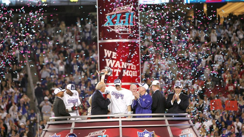 PHOENIX, AZ - FEBRUARY 03: Eli Manning of the New York Giants hoists the Vince Lombardi Trophy after winning Super Bowl XLII against the New England Patriots on February 3, 2008 at the University of Phoenix Stadium in Phoenix, Arizona. (Photo by Sporting News via Getty Images)