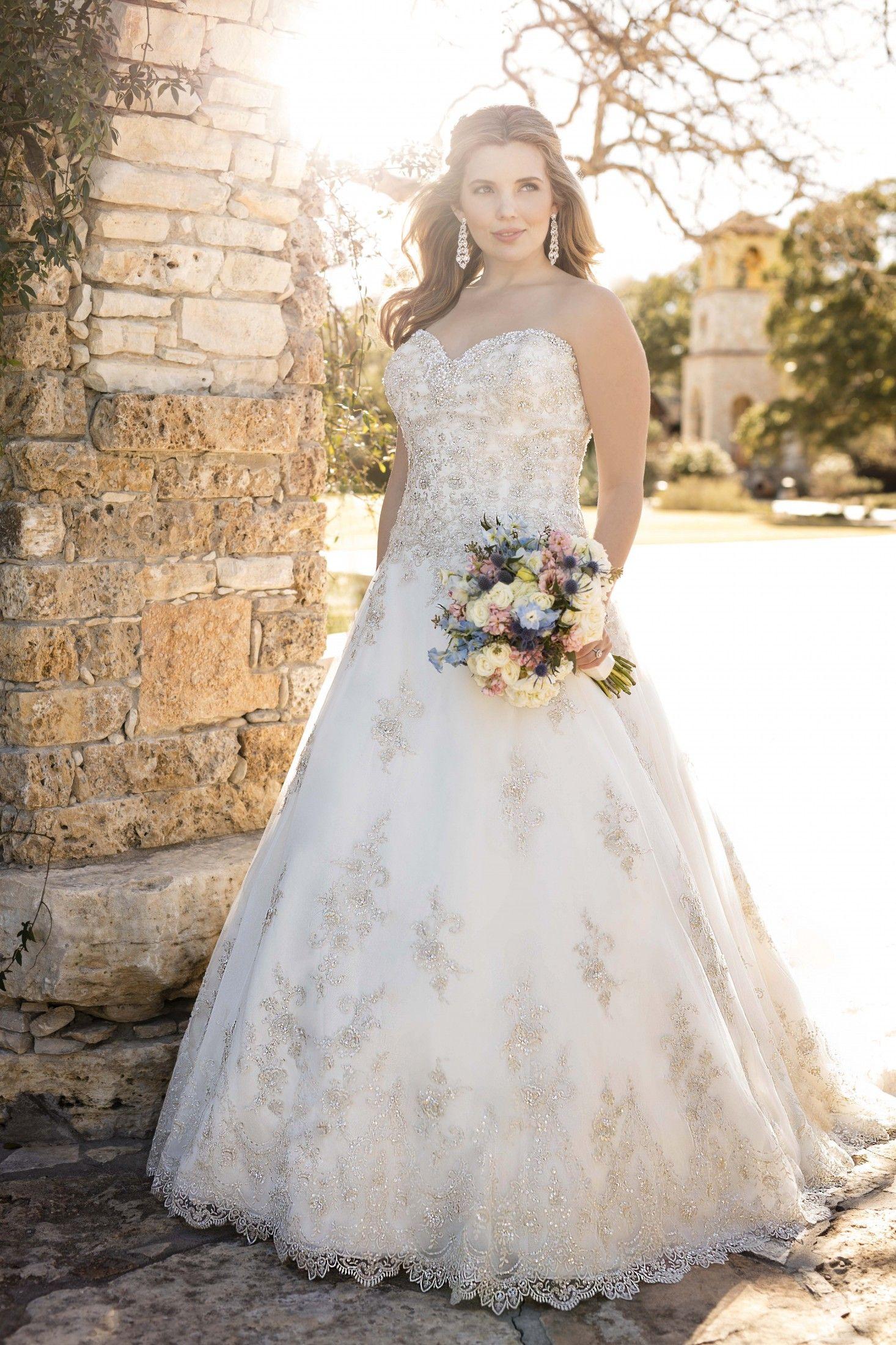 This figureflattering designer ALine wedding gown from
