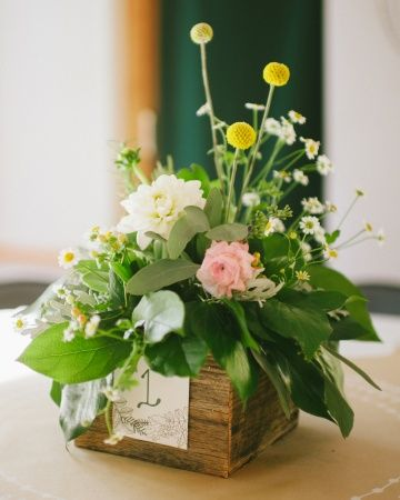 Rustic centerpieces in stained wood flower boxes
